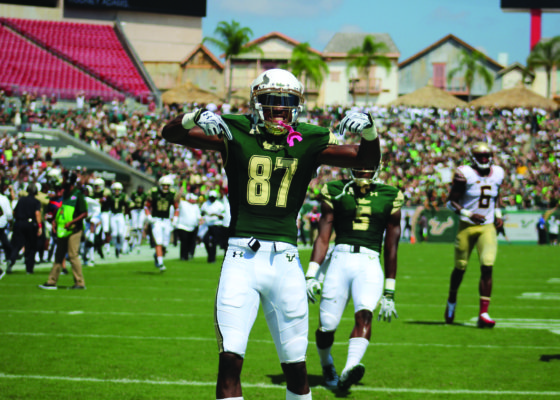 Quick Strike: Senior wide receiver Rodney Adams celebrates his 84-yard touchdown reception. Flowers threw the long touchdown pass on the first play of the game and set the pace for a high-scoring football game.