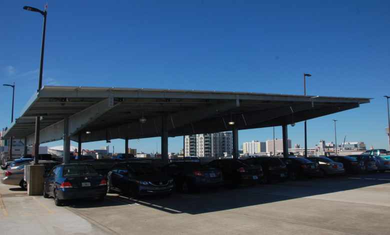 Solar Power: The installation of of new solar car ports, like the ones shown above from the parking garage, will be the first project to contribute to the Green Revolving Fund. Delaney Brown | The Crow's Nest
