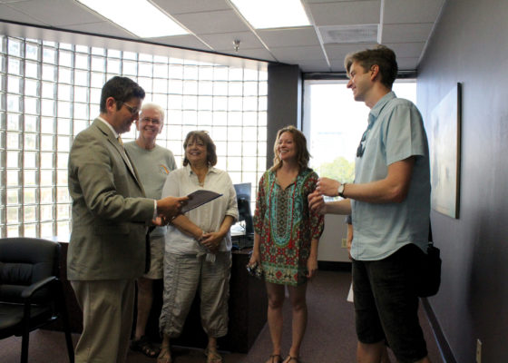 Thank You: David Higgins delivers a thank you letter for Charlie Crist to Interim District Director Steven Cary in Charlie Crist's office on Friday, March 24. Nicole Carroll | The Crow's Nest