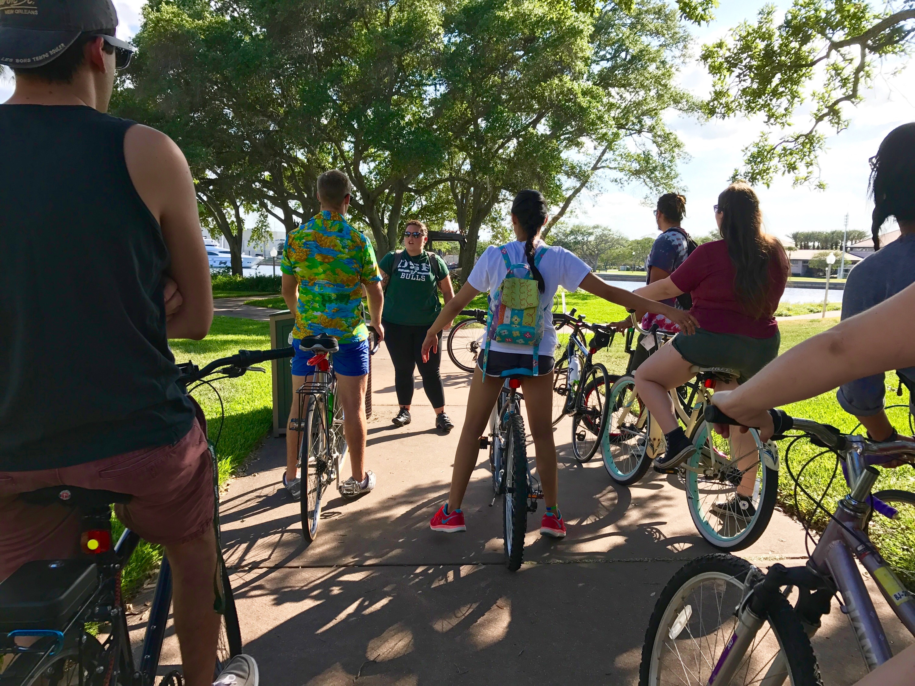 Gearing Up: Gabby Thornton directs a pack of bikers before a tour of downtown's murals. Courtesy of Kate Walker