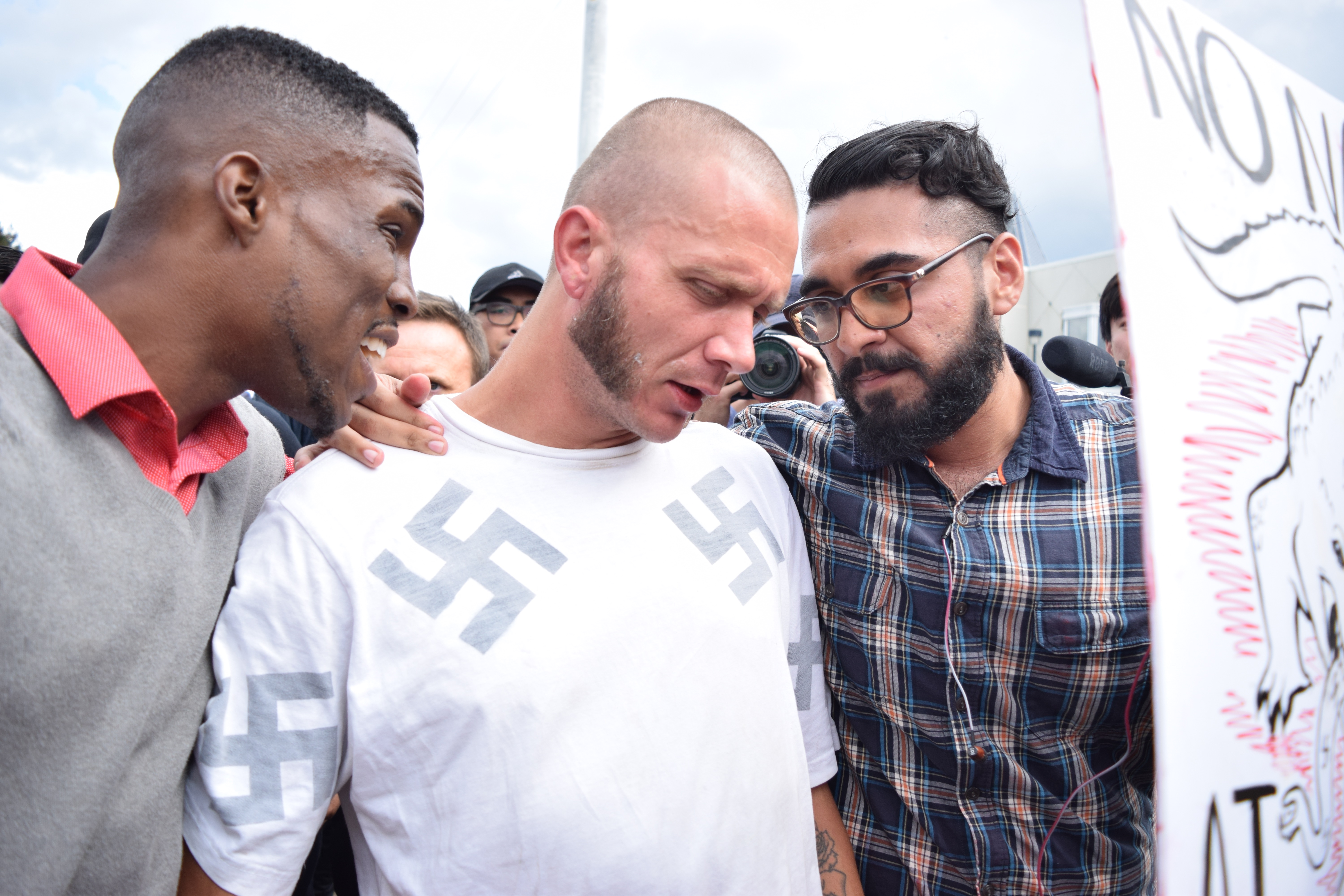 A protester escorted a white nationalist outside Richard Spencer's talk: 'He just smiled and called me a racist slur'